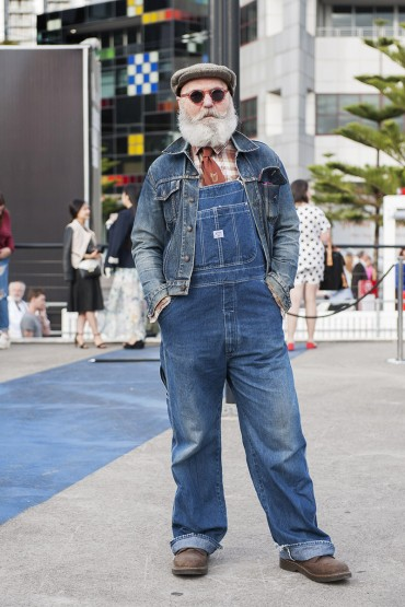 Street Style - VAMFF Docklands Saturday 22nd March 2014. National Graduate Showcase Runway.  Pic shows: RMIT fashion designer teacher Dr Peter Allan in Japanese demin label 'Big John overalls & Levis jacket.